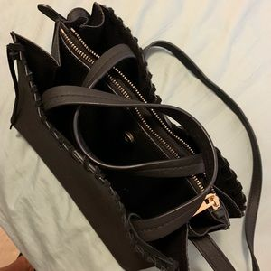 Black Leather Handbag with Suede Stitching